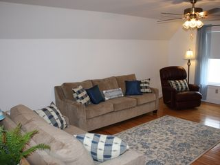 York Beach apartment photo - Plenty of seating options with a rocker arm chair for your vaction resting.