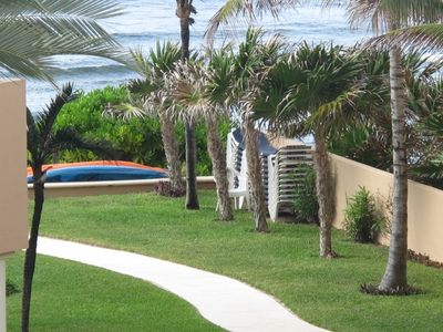 View of kayaks and lounge chairs for your use on the beach and pool.