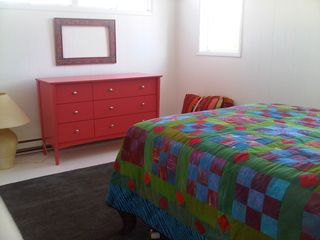 Second of four colorful private bedrooms. Ample closet and drawer space in each. - Peconic house vacation rental photo