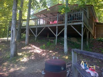 Lewis Smith Lake barn rental - View from detached deck and water. Rocks for fire on right.