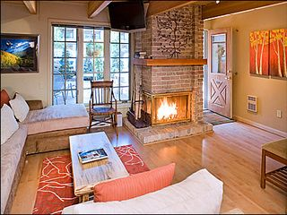 Aspen condo photo - Warmly decorated family room with wood burning fireplace