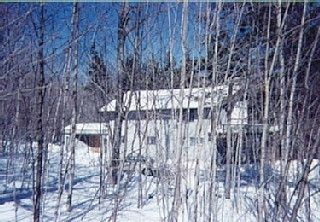 Mount Snow house photo - House glistening in sun - trails at your door - just another powder day!