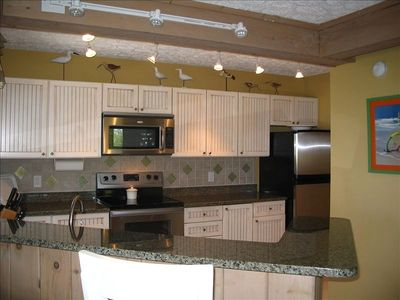 Beautiful custom kitchen,with granite counters and new stainless appliance.