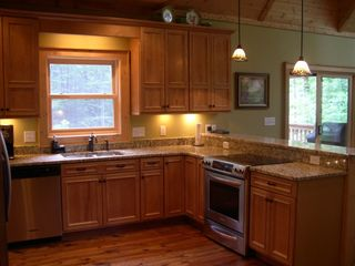 Cashiers house photo - Entertain in the new open kitchen with custom cabinets & Kitchen Aid appliances