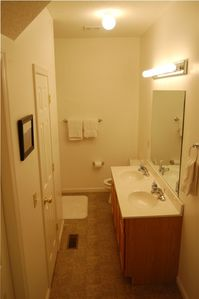 Downstairs Master Suite Bathroom with double sinks and shower
