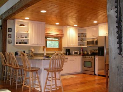 Kitchen with Granite and Stainless Steel Appliances - Lookout Mountain Cabin