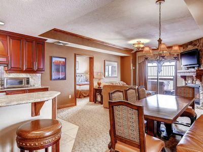 Gourmet kitchen with stainless steel appliances, granite counters, breakfast bar and seating; dining room easily seats eight (8); open concept living.