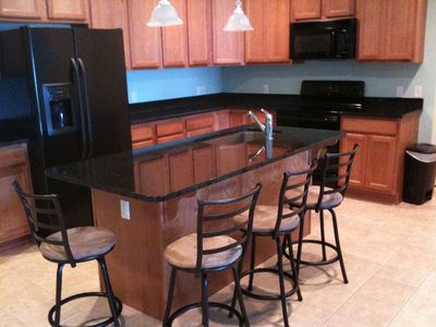 Kitchen with granite counter tops and seating for 4