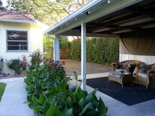 Los Angeles house photo - Expansive backyard with carport sitting and fenced in.