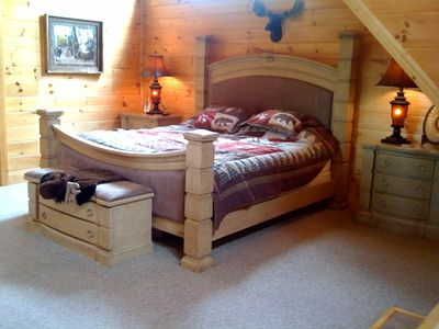Sevierville cabin rental - Master bedroom w/ bedside Jacuzzi + huge bath w/ double vanity sink + 50in HDTV