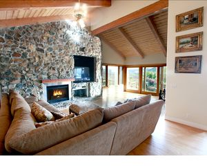 San Diego estate photo - comfy sectional sofa with cozy fireplace