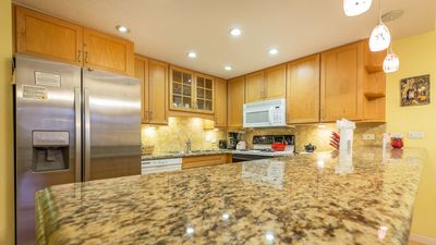 Fully equipped kitchen with granite counter tops and a large refrigerator
