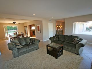 Palm Desert house photo - Living room. Kitchen, dining room and pool are just steps away.