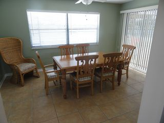 "Hernando Beach house photo - The ""Sun Room"" and Dining Room have views of the pool and c..."