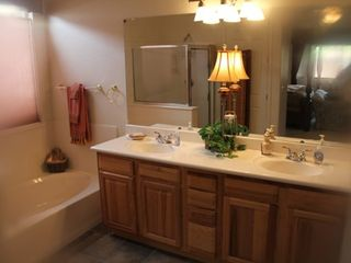 Surprise house photo - Large Master Comfort Room -- Walk-in Shower with foot tub -- His and Hers lavs