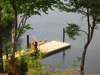 Huddleston cabin photo - Private floating dock in deep water offers two boat slips and a swimming ladder.