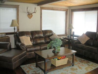 Family room with comfy couches and rustic feel!