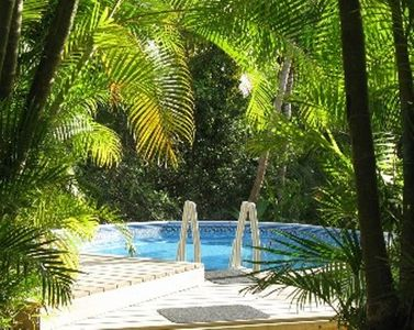 Relax poolside, adjacent to the Humacao Natural Reserve.