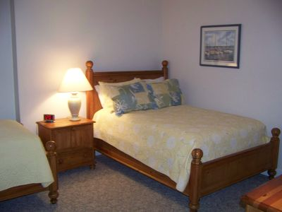 Downstairs, Full & Twin beds this room. Full bath across the hall. 1/2 bath too.