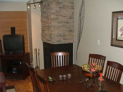 Cozy corner fireplace and dining area that seats 8.