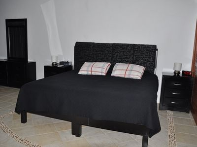 King size bed, tile floor throughout