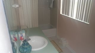 Lindfields house photo - Shared Bathroom with tub and shower over