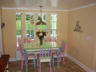 Old Naples house photo - The kitchen also features banquette dining table with seating for six.