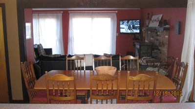 New dining table (comfortably seats at least 10) overlooking living room & deck.