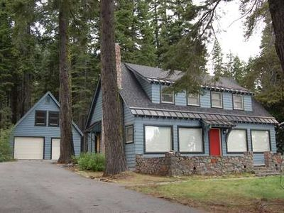 lovely old Tahoe split lakefront home with grassy front yard