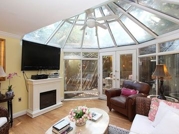 The Solarium/Family Room with covered terrace beyond. Is the TV large enough?