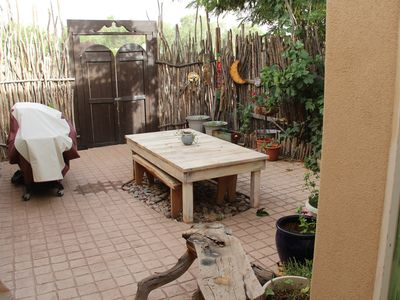 Wonderful private backyard complete with table, bences, and BBQ grill.