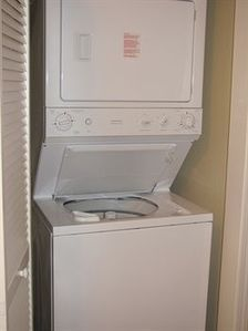 Stacked washer/dryer for insuite laundry needs.
