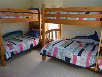 Downstairs bedroom with two sets of bunk beds and a TV for the kids!