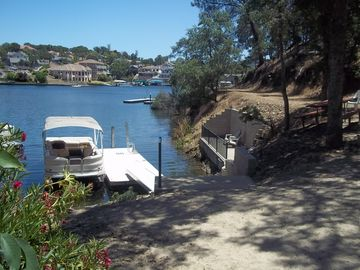 Copperopolis house rental - Private dock, deck and sandy area with shade and cove for swimming.