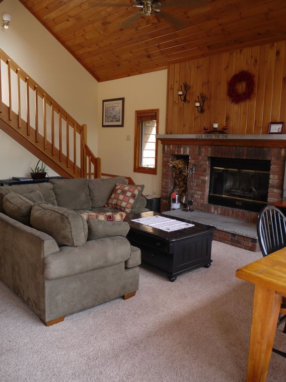 Main level living area with fireplace.