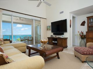 Providenciales - Provo condo photo - Living room with 65 inch flat screen TV, sound bar, & Blue Ray DVD player