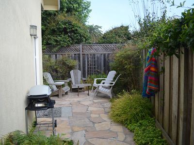 sweet private patio with 4 adirondack chairs and gas BBQ!