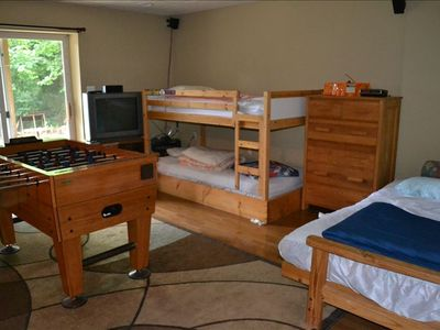 basement with bunk bed(twins) and queen futon, full bath