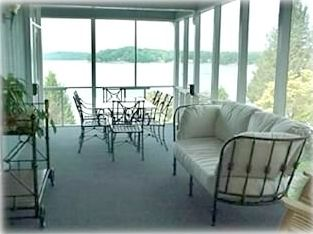 Screened in porch with beautiful view of the lake and dock!