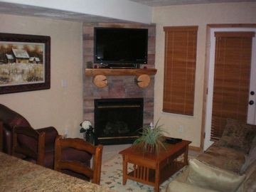 Living room, flat screen TV, gas fire place. Eastern deck through french doors