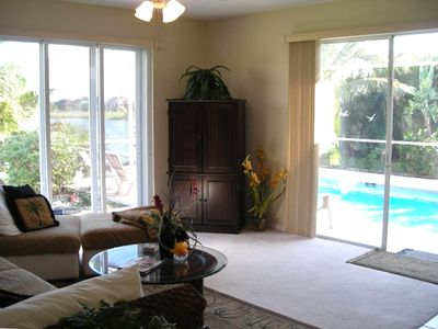 Family room off of kitchen with views of the pool and lake