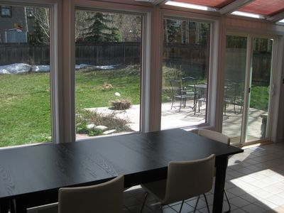 Spacious dining room and back patio - each seats eight comfortably.