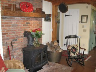 Woodstock house photo - Woodstove in dining room