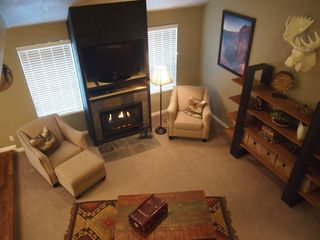 Cottonwood Heights townhome photo - Comfortable living room with ample seating, vaulted ceiling, fireplace, TV