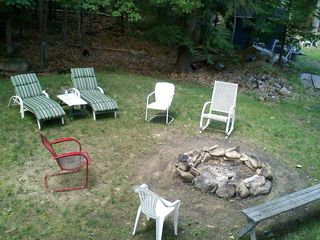 Moultonborough cottage photo - camp fire pit and horse shoe pit in yard as well as lawn furniture supplied