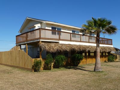 Enjoy views of the beach from the top deck or entertain downstairs.