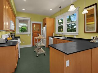 Seattle house photo - Stone Counters, Gas Range, Dishwasher, Microwave and Plenty of Counter Space