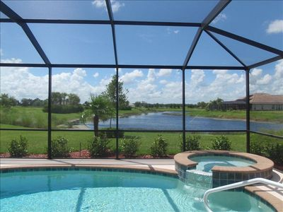 Private enclosed screened lanai with heated pool and spa