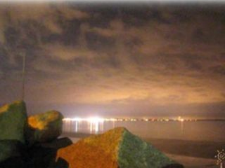 Saco house photo - Night lights from Old Orchard bouncing off the Bay