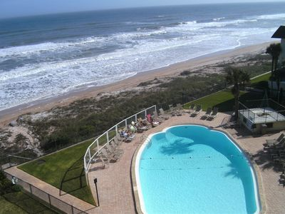 Balcony View of outdoor swimming pool and Ocean